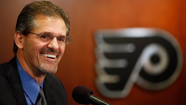 Ron Hextall is all smiles upon being introduced to reporters as Philadelphia Flyers GM at a media conference on Wednesday.