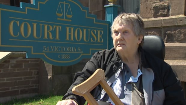 Jim Mitchell was called for jury duty but there's no way for him to get inside the Amherst courthouse on his own.