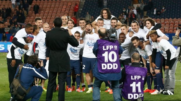 Paris Saint-Germain's squad pose for a group photo for officials after a French league one soccer match between Paris-Saint-Germain and Rennes on Wednesday.