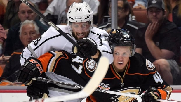 Los Angeles Kings centre Jarret Stoll, left, and Anaheim Ducks defenceman Hampus Lindholm battle for the puck during the first period in Game 2 in Anaheim.