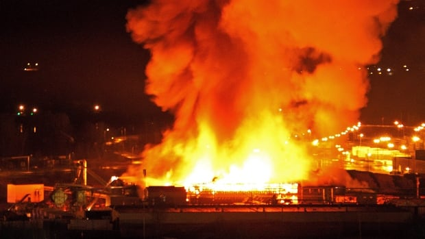 A large fire burns at the Lakeland Mills sawmill in Prince George, B.C., on Tuesday April 24, 2012. An explosion rocked the sawmill just before 10 p.m. local time setting off a fire that engulfed the facility.