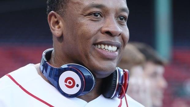 Apple is reportedly in talks to acquire Beats Electronics, the headphone and music streaming company co-founded by rap star Dr. Dre, for $3 billion.
