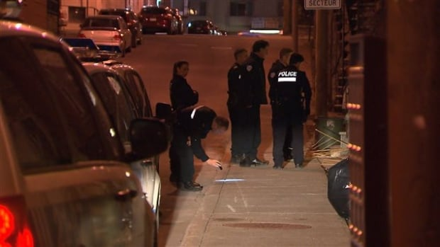 Montreal police at the scene of a shooting early Friday morning on Saint-André Street.