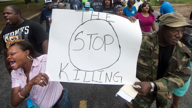 Residents protest outside the Hearne police department after a 93-year-old woman was shot and killed by a police officer on Tuesday.