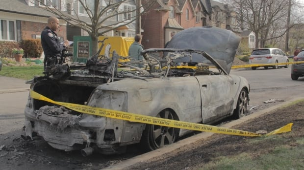 A burned car at the scene of 20 Burnham