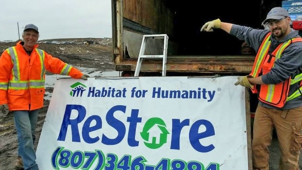 Thunder Bay's Habitat for Humanity ReStore is looking through the items people bring to the landfill this week to see if any of it can be salvaged for use or sale. Store manager Tyson Neill, right, said they are filling up a tractor trailer with a wide variety of items.