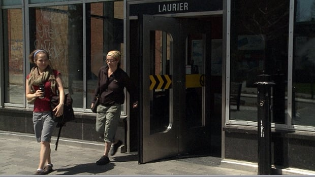 Joslin Webster (left) and Michelle Kennedy exit the Laurier Metro doors. They were attacked by a dog at this unstaffed exit and entrance over the weekend.