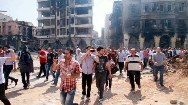 Syrian civilians return to Homs, Syria after government troops entered the last rebel-held neighbourhoods as part of an agreement that also granted opposition fighters safe exit from the city.