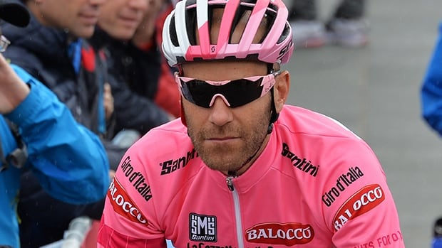 Canada's Svein Tuft, wearing the pink jersey of leader of the race, at the start of the second stage of the Giro d'Italia, Tour of Italy cycling race, from Belfast to Belfast, Northern Ireland on Saturday.