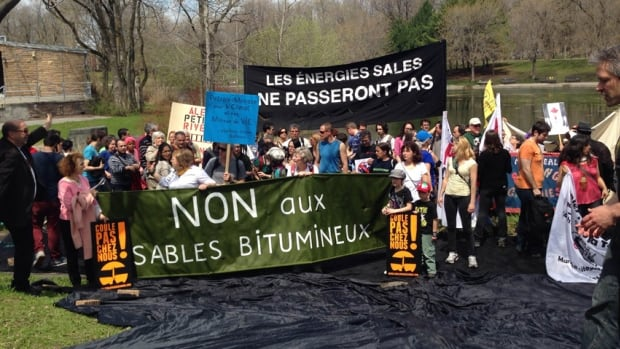 Montreal environmentalists stage a fake oil spill at Lafontaine Park.