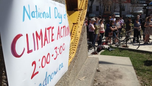 People gathered near the Osborne Street bridge at Gerald James Lynch Park Saturday afternoon as part of the National Day for Action on Climate change.