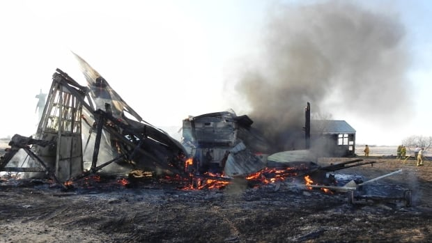 Two female youths were arrested in connection with a fire on a Souris, Man. farm fire.