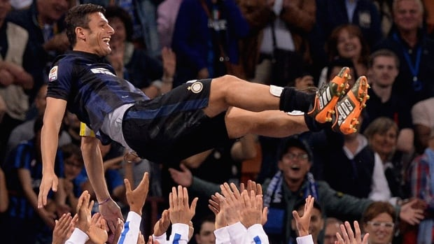 Inter Milan captain Javier Zanetti is hoisted by his teammates following his last match at a sold-out San Siro Stadium on Saturday, a 4-1 Milan victory.  The 40-year-old will retire after 19 seasons.