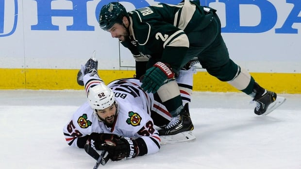 Blackhawks forward Brandon Bollig, bottom,  was suspended two games on Saturday for his check from behind against Wild defencenan Keith Ballard, top, in Game 4 of their NHL Western Conference semifinal.
