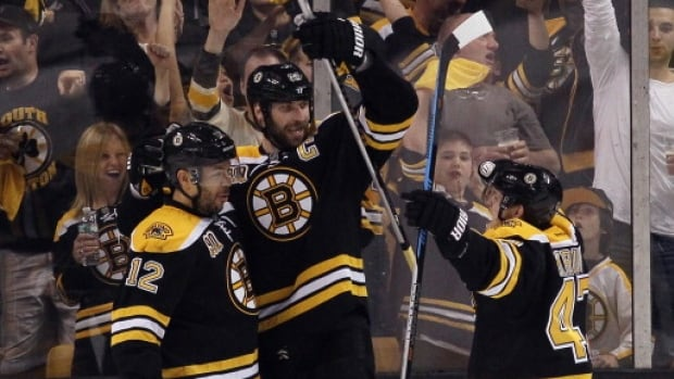The Boston Bruins celebrate a power-play goal by Jarome Iginla (12), who is joined by defencemen Zdeno Chara, centre and Torey Krug Saturday against the Montreal Canadiens.