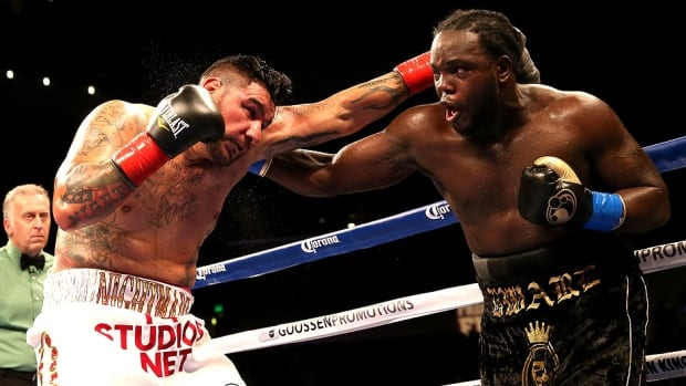 Bermane Stiverne, right, battles Chris Arreola in their WBC heavyweight championship match at Galen Center in Los Angeles on Saturday night. Stiverne won in a six-round technical knockout.