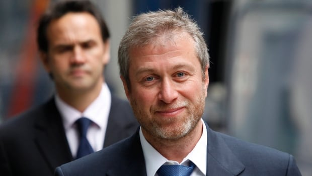 This Oct. 4, 2011 file photo shows the owner of England's Chelsea Football Club, Roman Abramovich as he leaves court in London. A new study of the super-rich finds that London has become the capital of the world's wealthiest, with more billionaires than any other city in the world. Abramovich is number 9 on the list, published by The Sunday Times.
