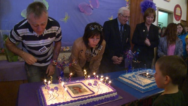 From left, Bernie and Louise Mercer blow out the candles on birthday cakes for their children, Riley and Alex. At right is Lt.-Gov. Frank Fagan and his wife, Pat, who also lost a son to cancer.