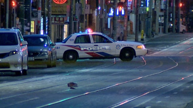 Jay McGinn died after days after being struck by a vehicle on Dundas Street West, at Augusta Avenue. Police say he had been waiting to enter a taxi. An Oshawa woman now faces upgraded charges in connection with his death.