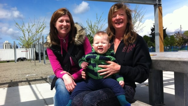 Members of Jim Green's family have been involved in the planning of a commemorative space at Trillium Park. Green's daughter Alexandra Rutherford, on the left, his grandson Thomas, and his partner Heather Redfern, are pictured at the 'Activation Station'.