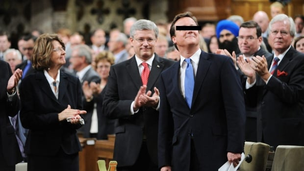 Prime Minister Stephen Harper and Parliament applaud (REDACTED) prior to his address in Ottawa on Sept. 22, 2011.