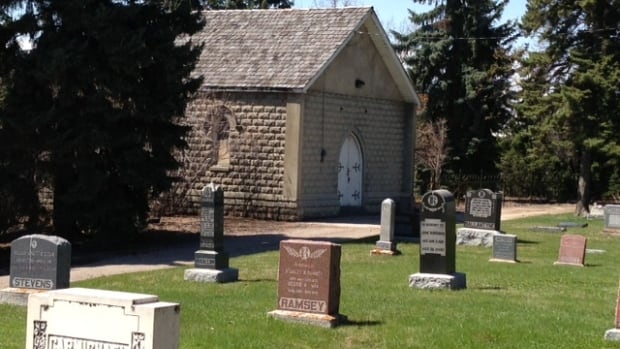 A chapel at Calgary's Union Cemetery was set on fire in March. Police are looking for two suspects.