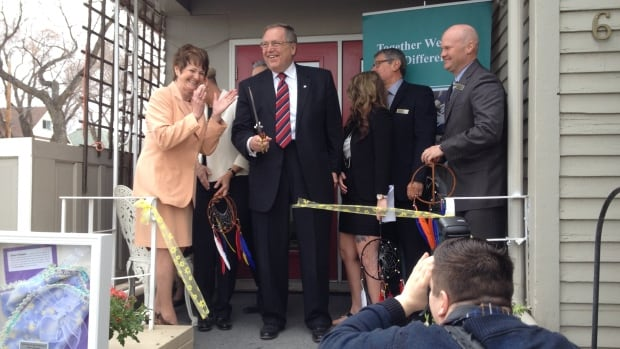 Mayor Don Atchison cuts the ribbon to official open the 'Sweet Dreams' project in Saskatoon.