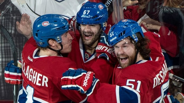 The Canadiens' Max Pacioretty, middle, celebrates his goal against the Bruins with teammates Brendan Gallagher, left, and David Desharnais during the second period on Monday in Montreal. The Canadiens won 4-0 to force a Game 7 in Boston on Wednesday.