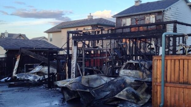 A fire early Tuesday morning destroyed two garages and damaged several nearby homes in Coventry Hills.