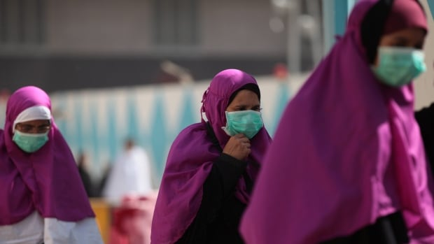 Muslim pilgrims wear surgical masks to help prevent infection from a respiratory virus known as the Middle East respiratory syndrome (MERS) in the holy city of Mecca, Saudi Arabia, on Tuesday.