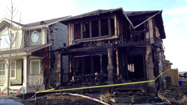 An early morning fire gutted one house and caused exterior damage to another.
