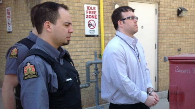 Guards escort accused killer Douglas Hales from Saskatoon Court of Queen's Bench on Wednesday, May 14.