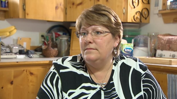 Leah Rissesco says her family is in dire financial straits because their home, located about 50 kilometres outside of Halifax, is just 300 metres from an arbitrary boundary that determines entitlement to a living allowance.