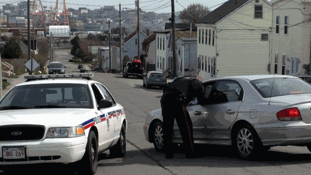 Saint John police kept a part of Lancaster Street blocked off on Wednesday as they continued to investigate a violent confrontation that left one man dead and another in hospital.