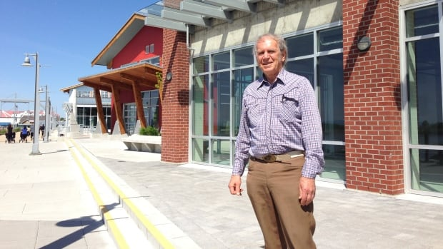 Richmond city councillor Harold Steves in front of Imperial Landing development.