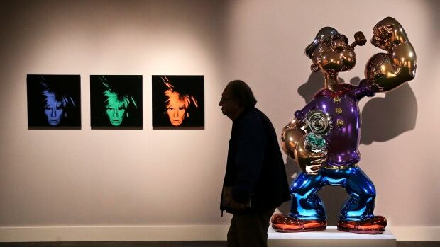 Andy Warhol's Six Self Portraits and Jeff Koons' Popeye were among the highlights of the auction.