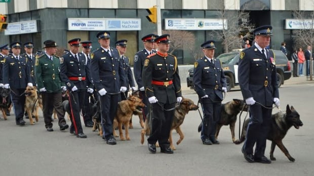 The funeral procession for Thunder Bay police Cst. Joe Prevett began with K-9 units from across North America.