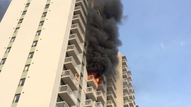 The fire broke out in an apartment in the View Towers building on Quadra Street in Victoria around 7 a.m. PT Thursday.