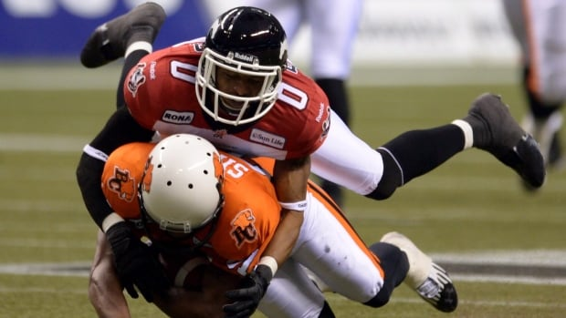 Calgary Stampeders' Quincy Butler tackles B.C. Lions' Geroy Simon during the first half of the CFL Western Final football game in Vancouver in 2012. The players' association wants full-contact practices limited to one a week.
