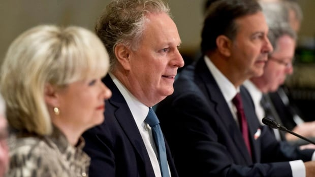 From 2012: Former premier Jean Charest, flanked by Julie Boulet, then-Minister of Employment and Social Solidarity and Sam Hamad, then-Minister of Economic Development, Innovation and Export Trade, meet with economic and labour representatives two years ago in Montreal.