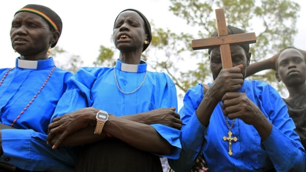 A 2010 file photo shows Christians praying in Sudan. A pregnant Christian woman in Khartoum was sentenced to death Thursday after she refused to refute her faith, according to her lawyer.