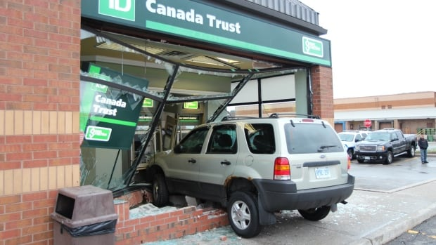An SUV carrying two people crashed into a bank early Friday morning as two people were trying to use the ATM.