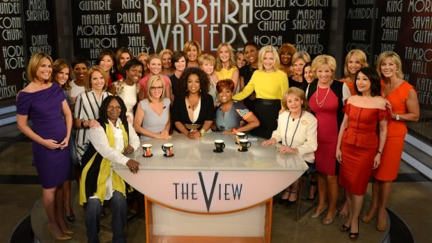 The current hosts of The View, including Whoopi Goldberg, Jenny McCarthy and Sherri Shepherd join Oprah Winfrey and other top female broadcasters for a photo with retiring TV pioneer Barbara Walters (seated at right) during a taping of her final co-hosting appearance on The View in New York.