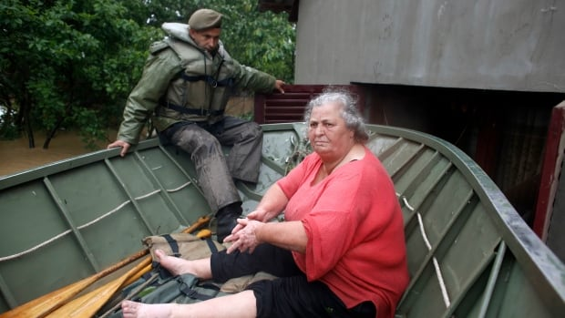 Thousands of people have been forced from their homes by flooding in Bosnia and Serbia.