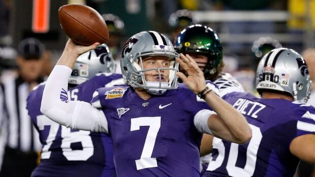 Collin Klein is shown throwing for Kansas State against Oregon during the first half of the Fiesta Bowl on Jan. 3, 2013, in Glendale, Ariz.