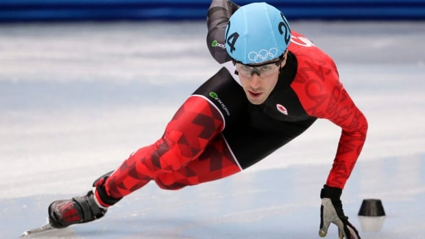 Michael Gilday competes in a men's 1500m short track speedskating heat during the 2014 Winter Olympics in Sochi, Russia.