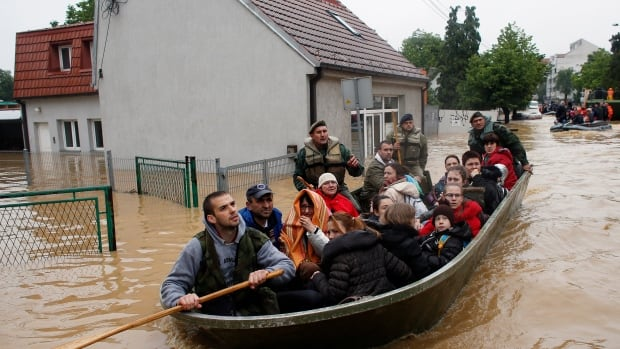 Serbian army soldiers transport people in the town of Obrenovac, southwest of Belgrade on Saturday.
