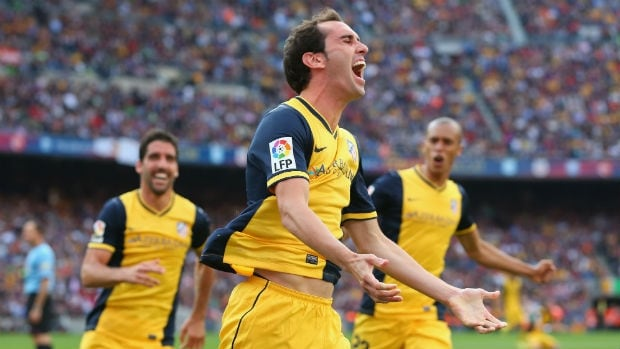 Diego Godin of Atletico Madrid celebrates his goal against Barcelona.
