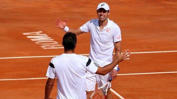 Canada's Daniel Nestor and partner Nenad Zimonjic celebrate their Italian Open victory.