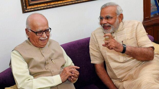 India's next prime minister Narendra Modi, right, talks to Bharatiya Janata Party (BJP) senior leader Lal Krishna Advani at Advani's residence in New Delhi, India, Sunday, May 18, 2014.